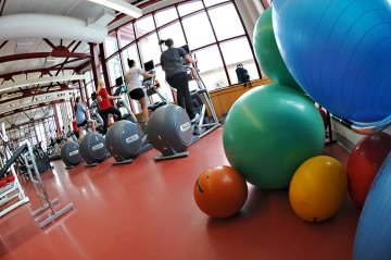 Students exercising in the fitness center