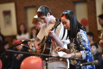 Students play music to celebrate Chinese New Year.